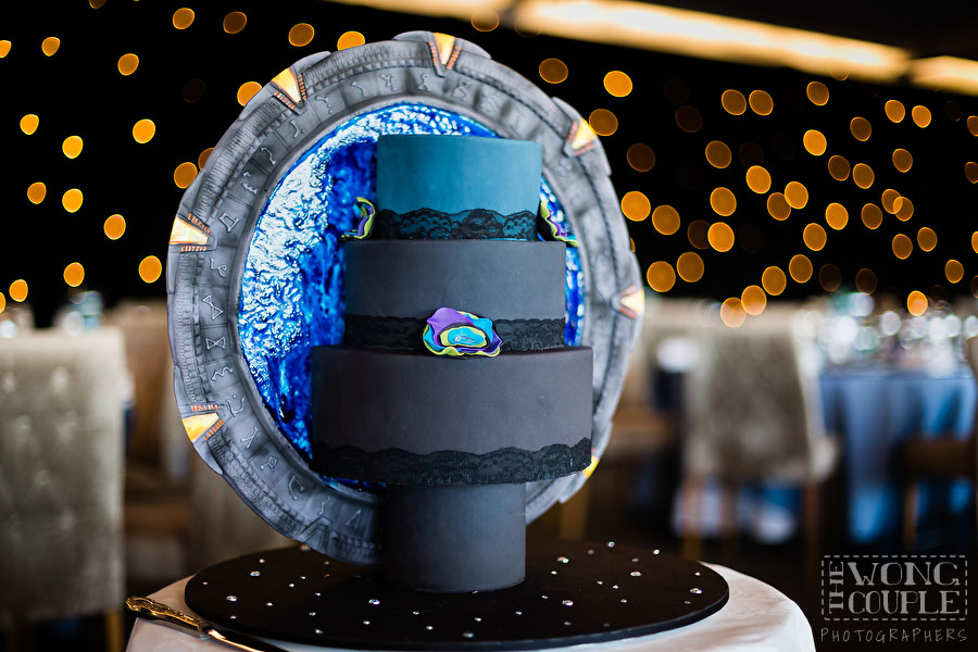 Photo of wedding cake at sci-fi themed wedding reception