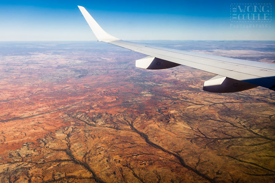 Vast red desert landscape in Western Australia, from airplane window