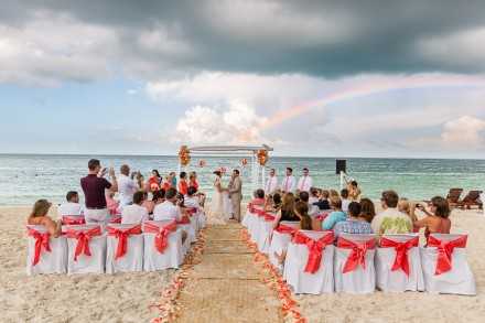 Destination wedding photographers, tropical beach wedding pictures, wedding ceremony with rainbow