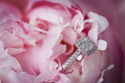 Macro wedding photography, pink peony with diamond engagement ring
